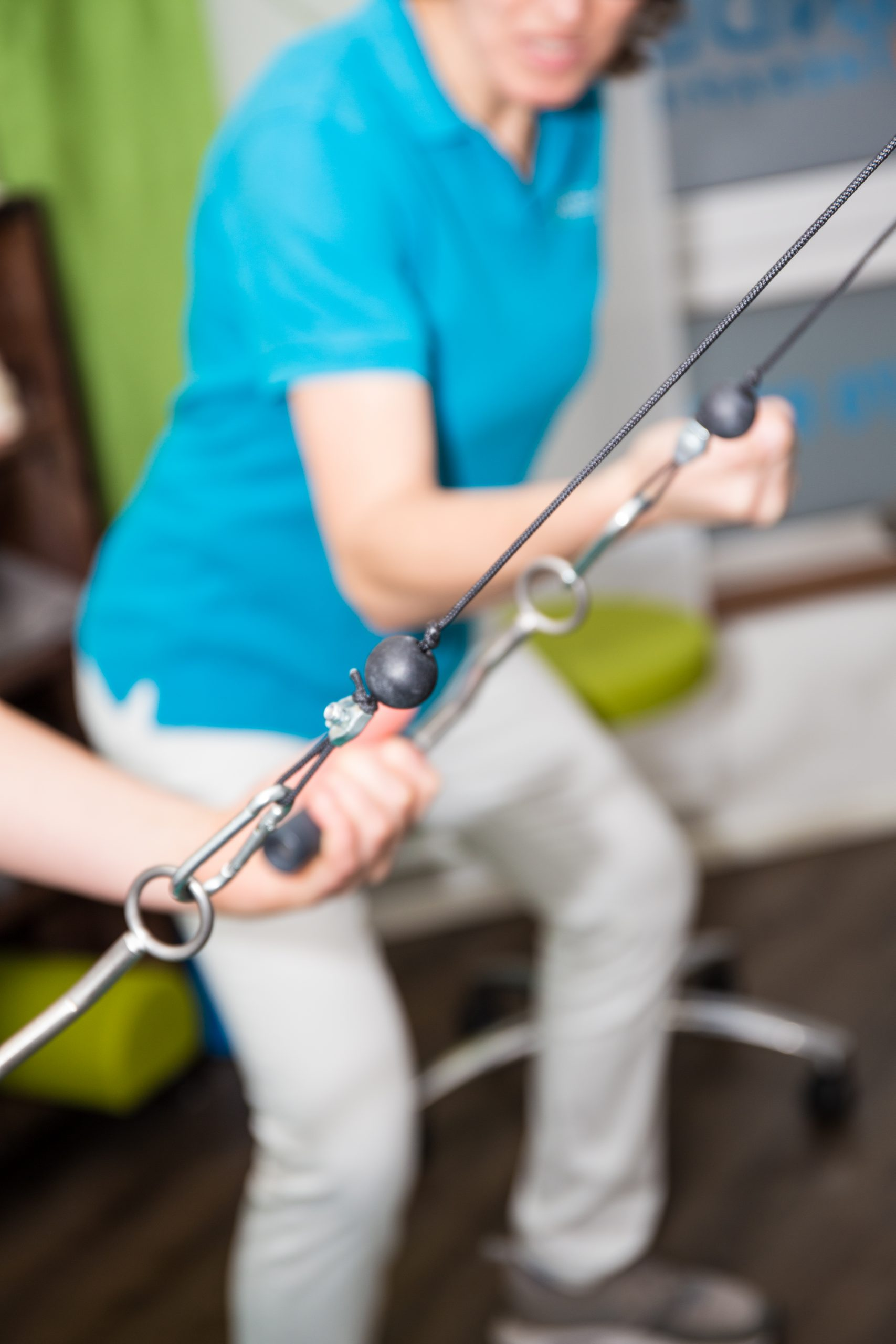 Allgemeine Krankengymnastik - Muskelaufbau mit Seilzug